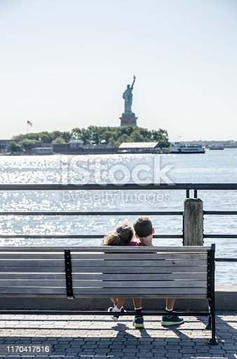 585604690 istock photo Two kids looking at Statue of Liberty 1170417516