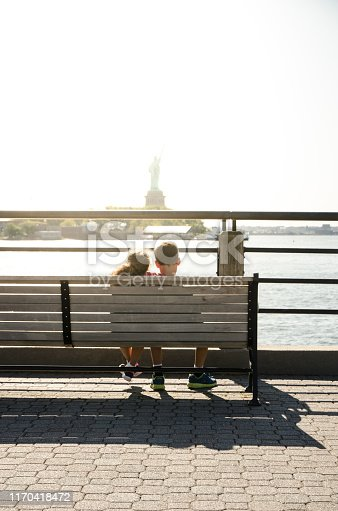 585604690 istock photo Two kids looking at Statue of Liberty 1170418472