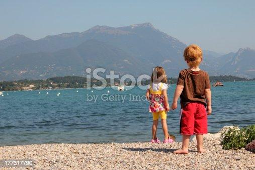 istock Two kids looking at the lake garda 177317790