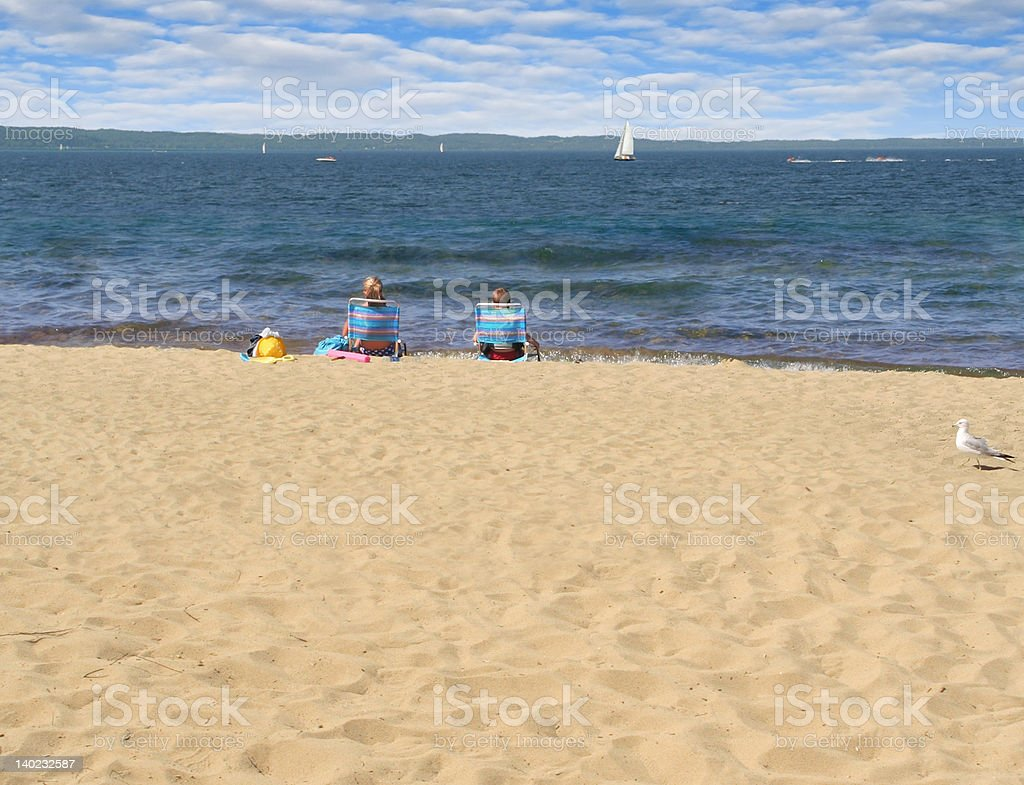 Two kids on the beach stock photo