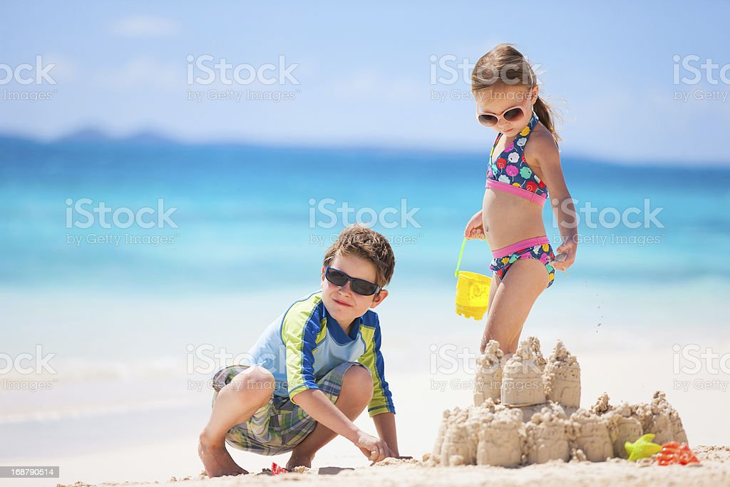 Two kids playing at beach royalty-free stock photo