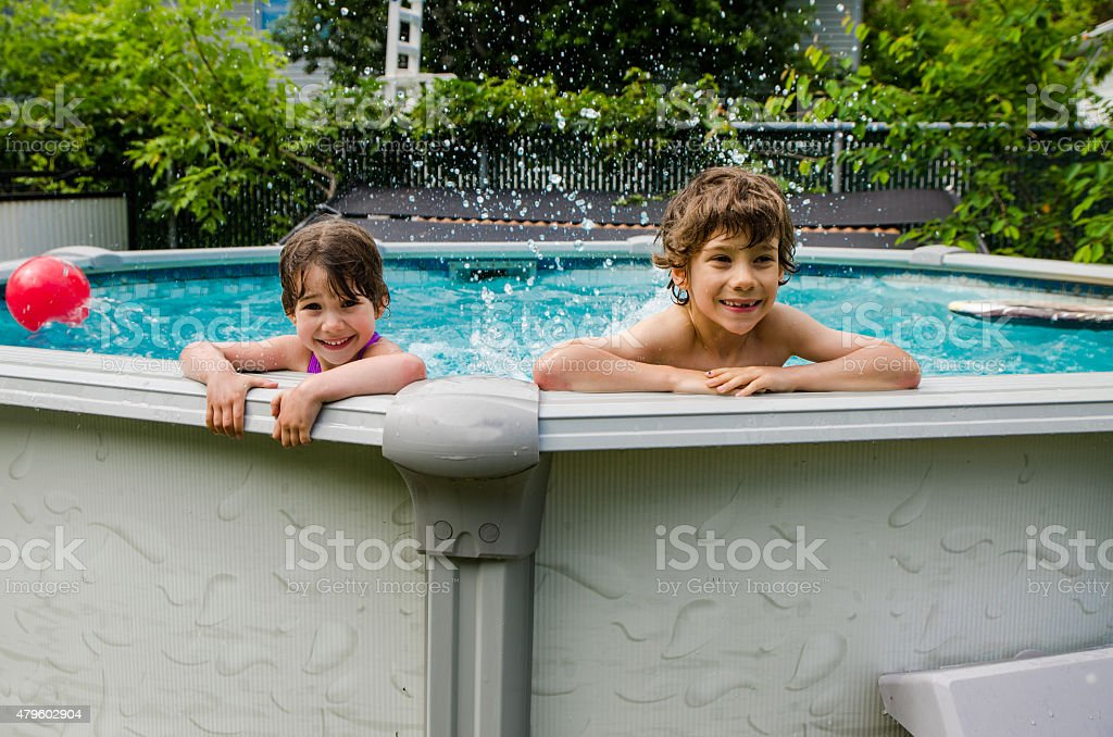 Two Kids Playing In Backyard Swimming Pool Stock Photo Download Image Now Istock