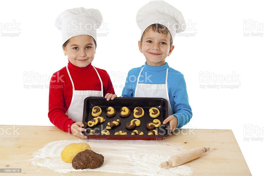 Two kids with baking on oven-tray royalty-free stock photo