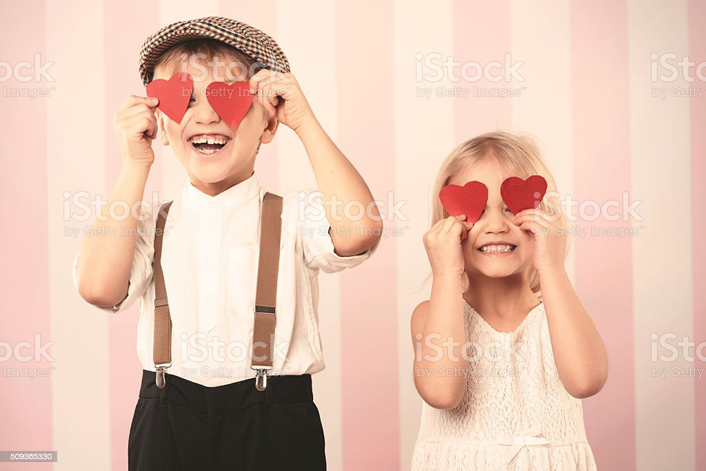Two kids with hearts on the eyes stock photo
