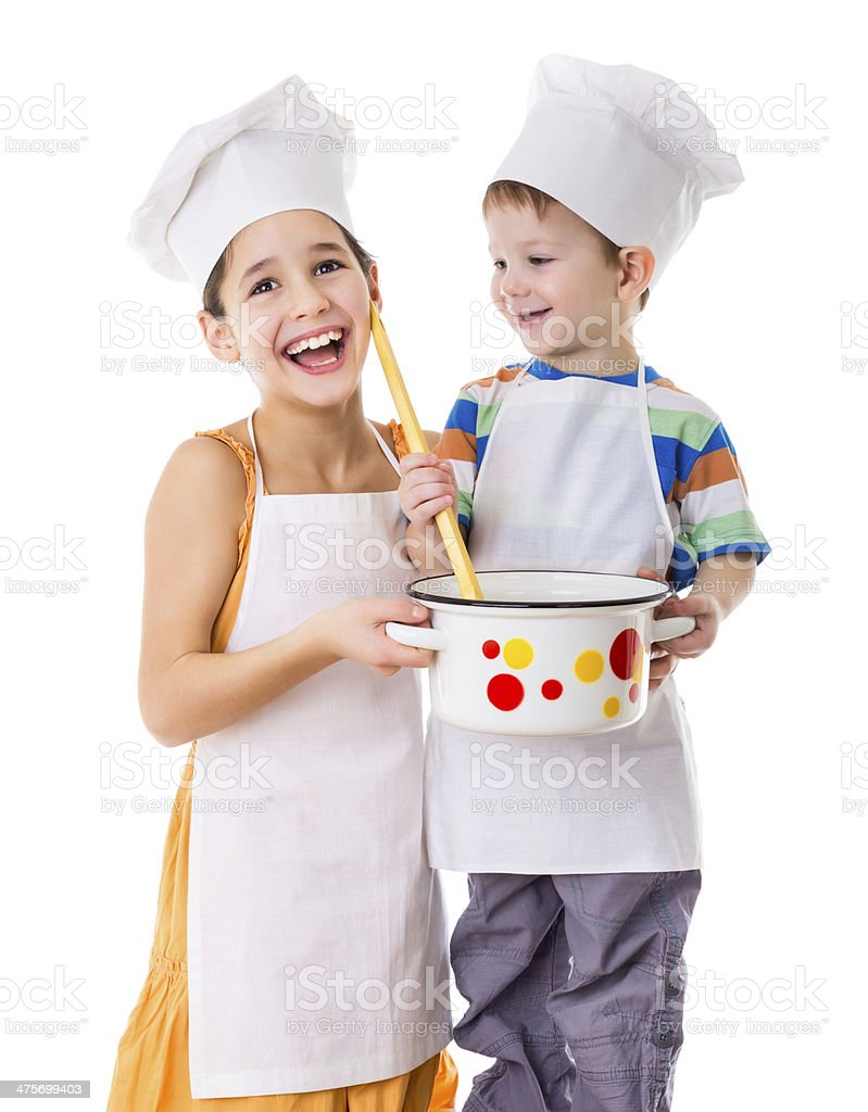 Two kids with pan and big ladle stock photo