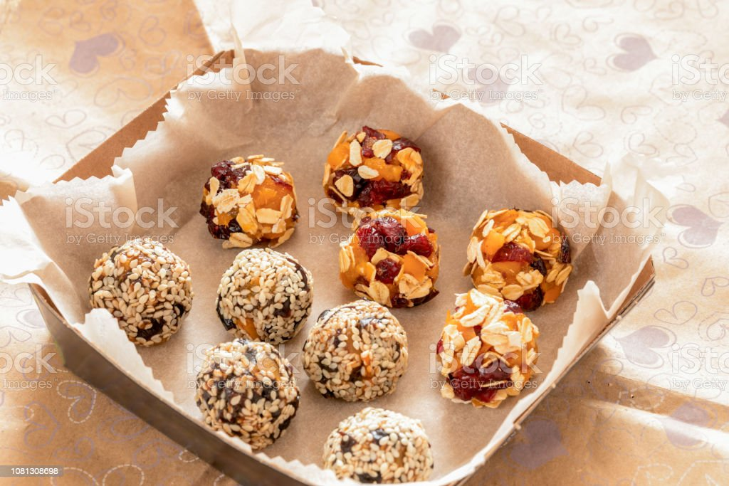 Two kinds of healthy handmade energy balls made from pieces of dried...