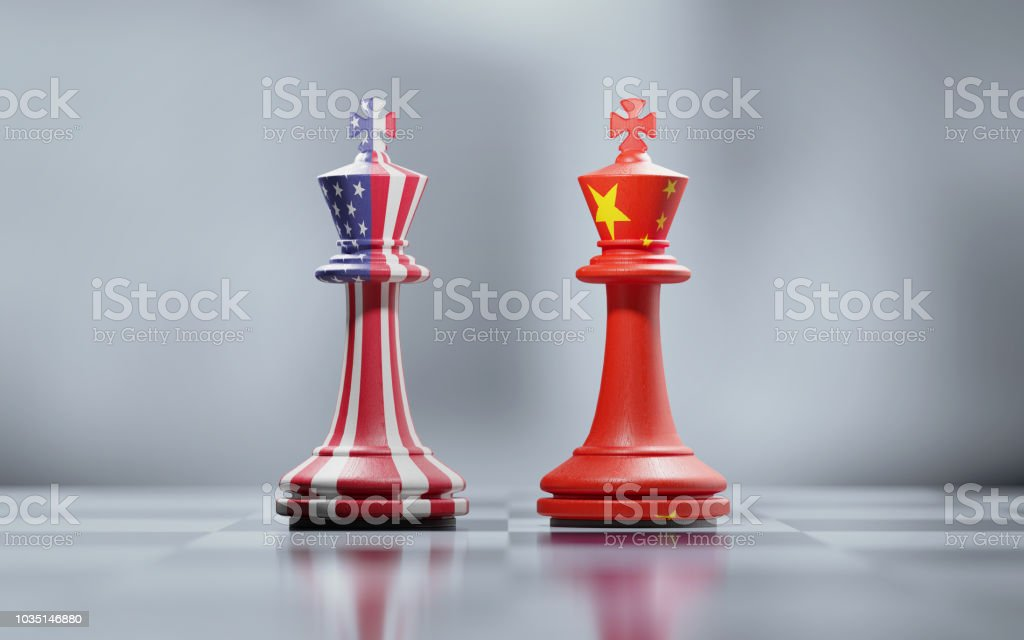 Two King Chess Pieces Textured With American And Chinese Flags On Black And White Chessboard stock photo