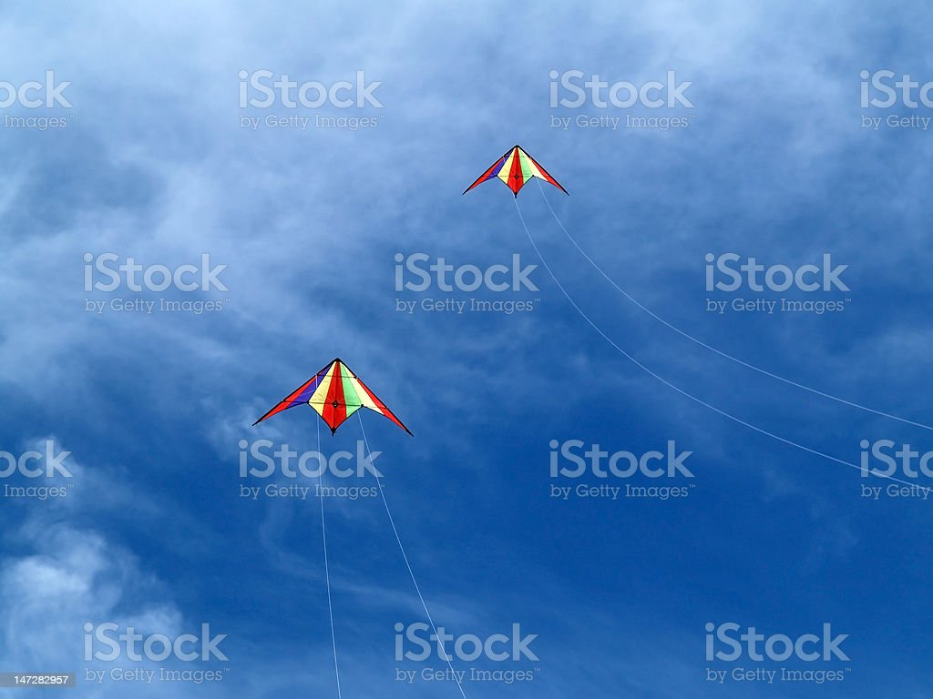 Two kites in the sky stock photo