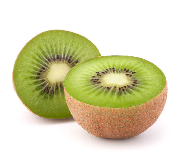 Two kiwi fruit sliced halves stock photo