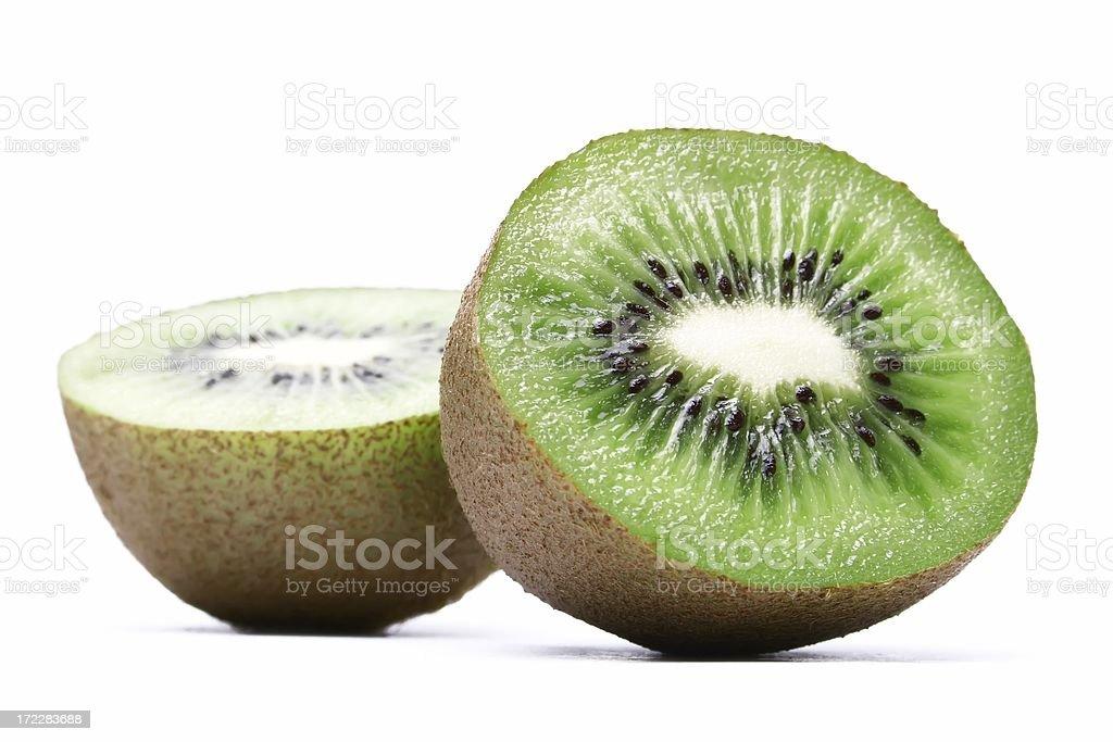 Two kiwifruit halves (isolated on white) stock photo
