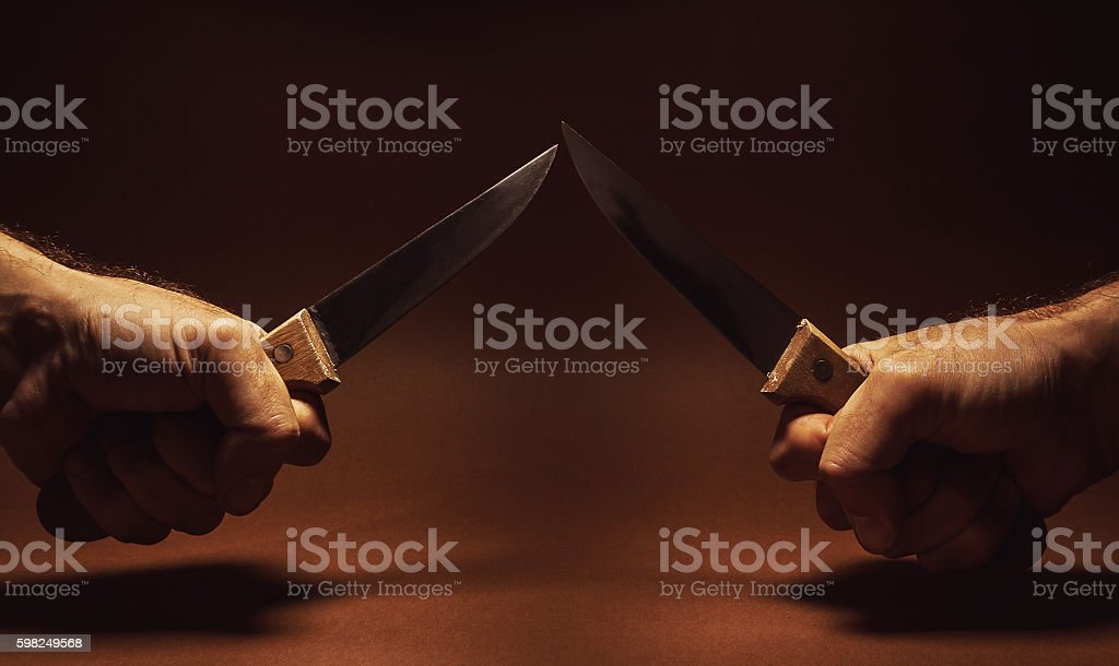 Two Knifes And Two Hands stock photo