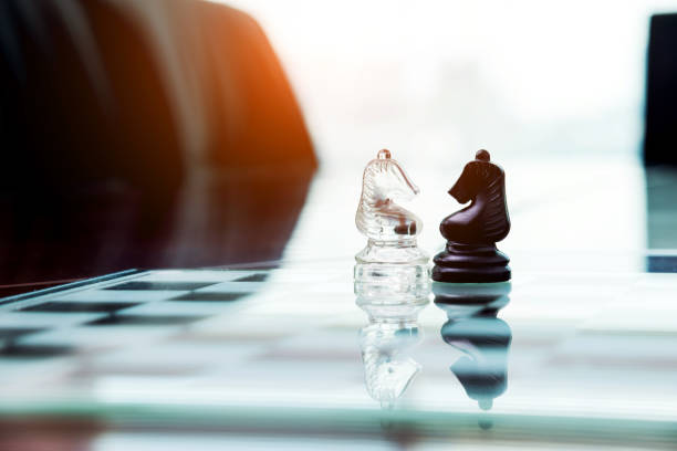 Two knights face to face on the table Two knights face to face on the table. confrontation stock pictures, royalty-free photos & images
