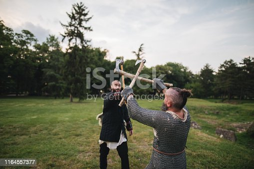 istock Two knights fighting with axes 1164557377
