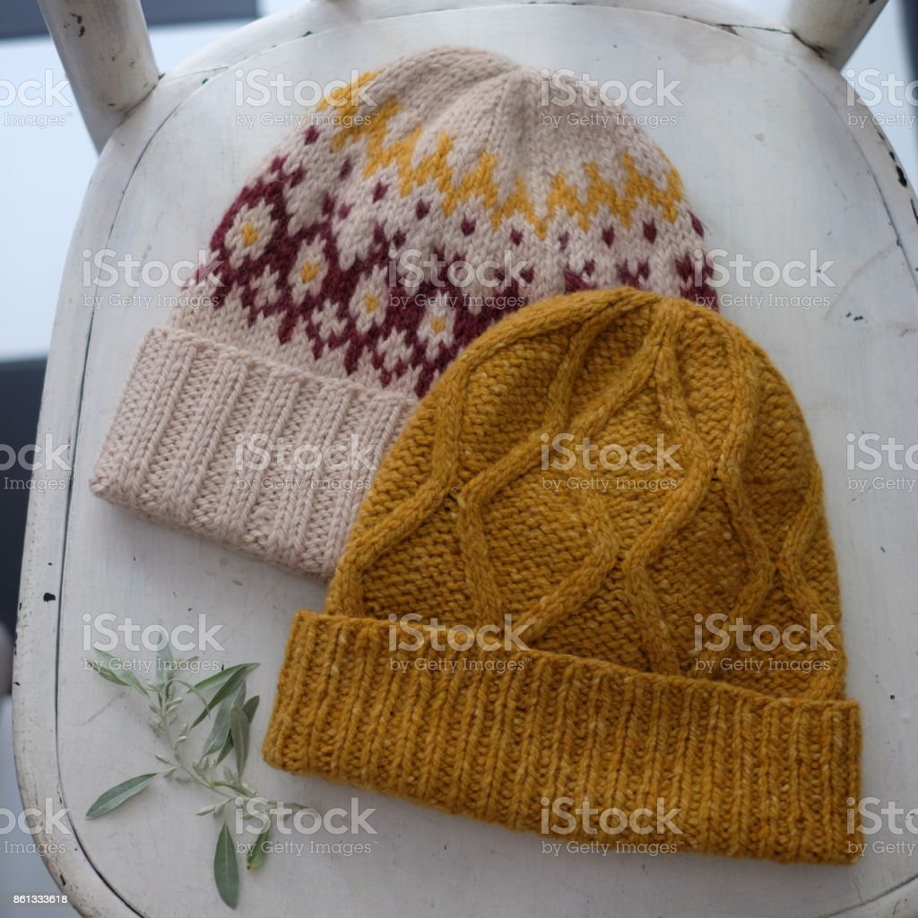 Two knitted tweed hats with a pattern stock photo