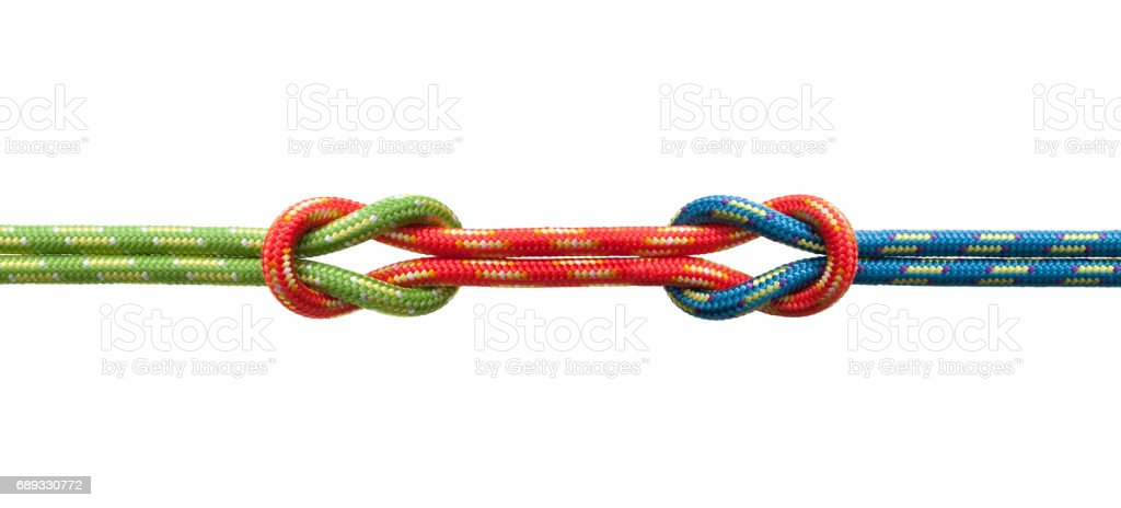 Two knots with three ropes stock photo