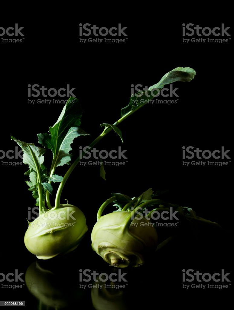 Two kohlrabies (German turnip or turnip cabbage) with leaves stock photo