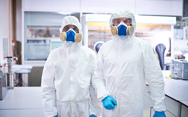 Two lab workers in protective wear stock photo