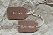 istock Two Labels Herzlich Willkommen Mean Welcome Paper 474409728