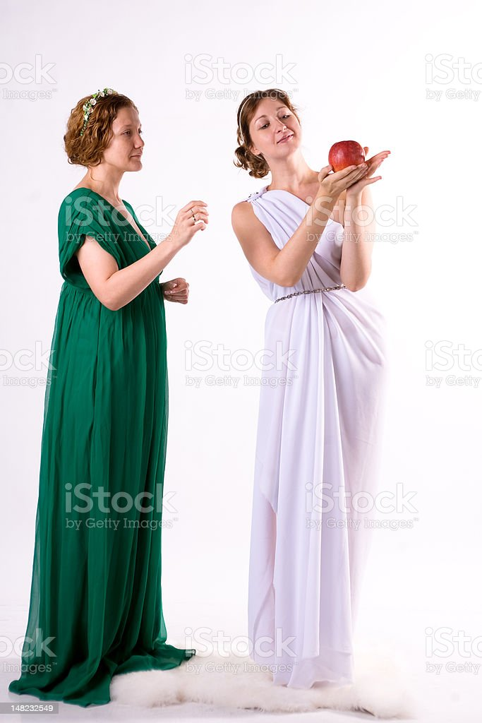 Two ladies and one apple royalty-free stock photo