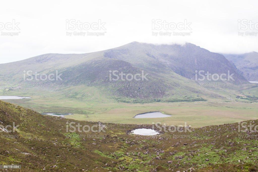 Two lakes and their mountains 2 stock photo