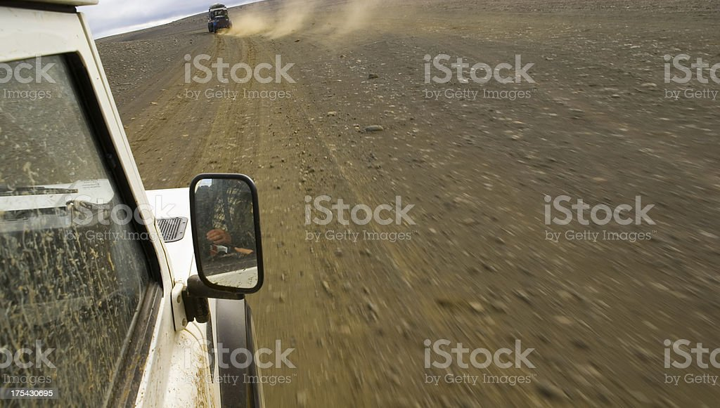 Two Landrovers Chasing Each Other stock photo