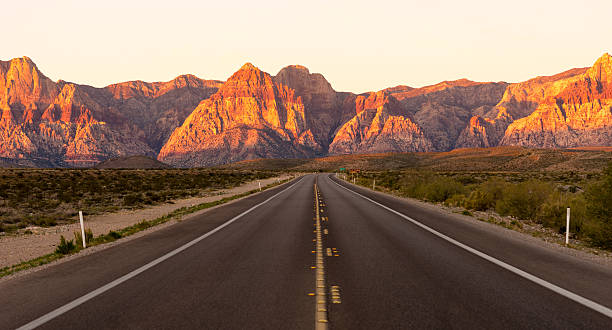 two lane highway red rock canyon las vegas usa - red rocks stock pictures, royalty-free photos & images