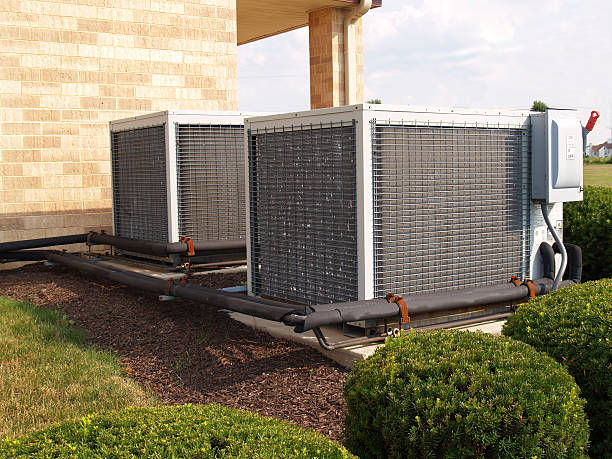 two large air conditioners stock photo