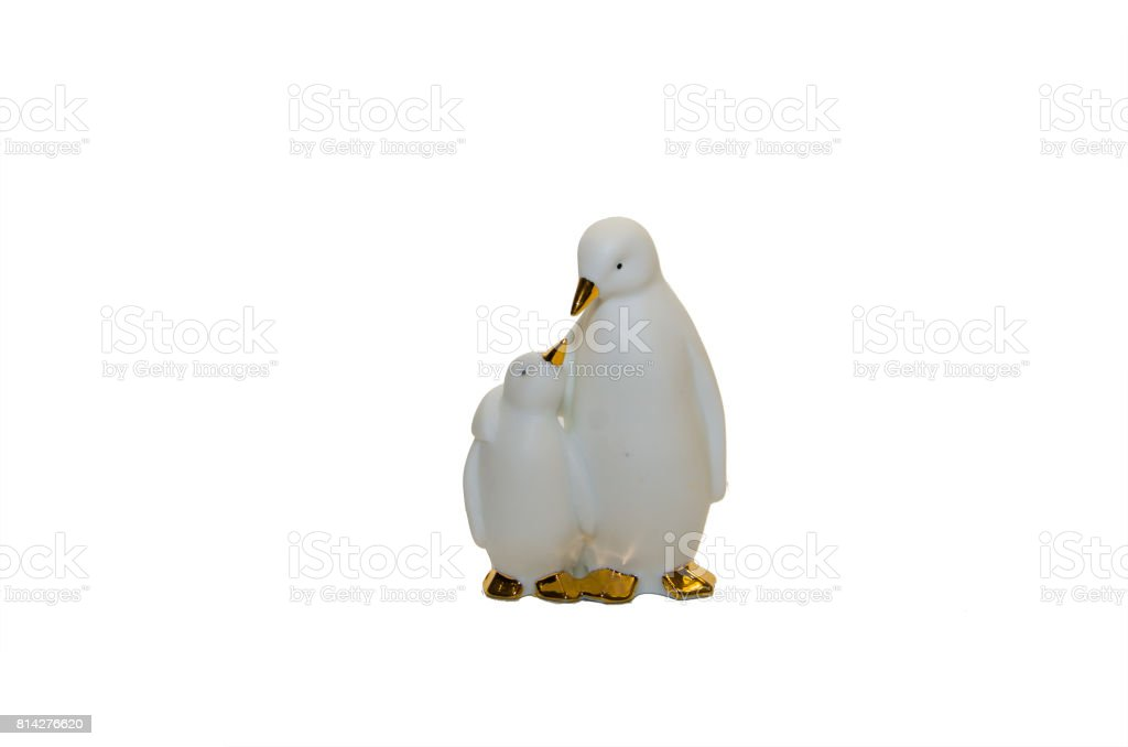 two large and small ceramic penguins on a white background stock photo