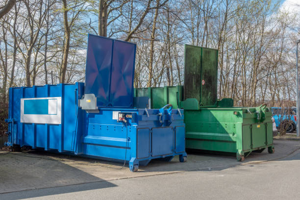 two large garbage compactors standing on a hospital site two large garbage compactors standing on a hospital site compactor stock pictures, royalty-free photos & images