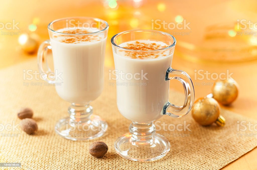 Two large glasses of eggnog served beautifully royalty-free stock photo