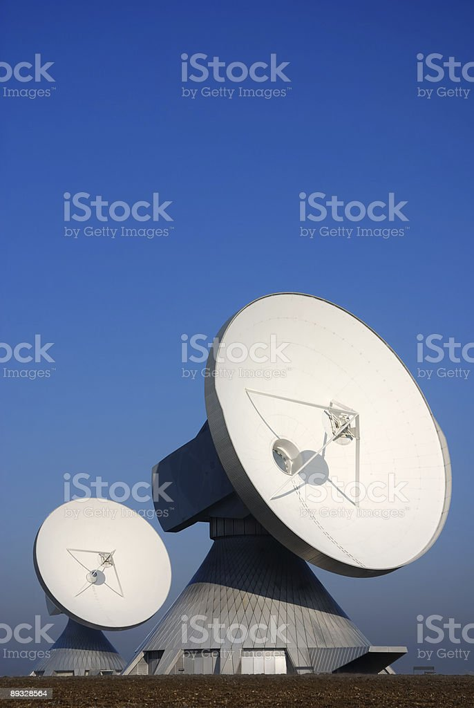 two large satellite dishes against clear blue sky  Antenna - Aerial Stock Photo