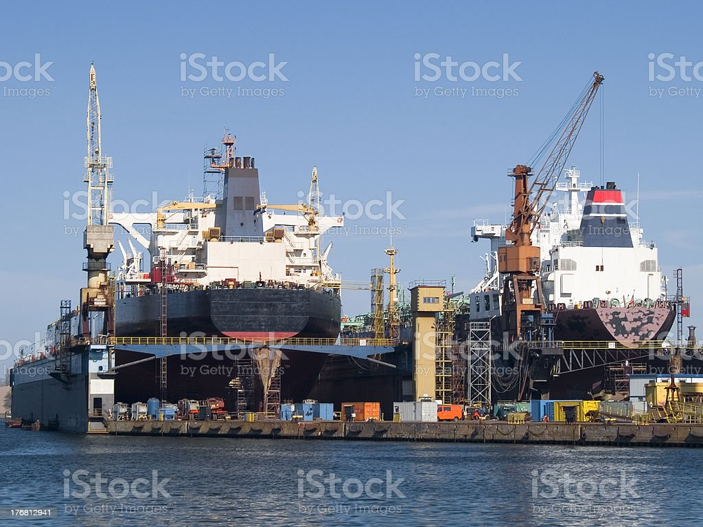 Two large ships side by side in a shipyard stock photo