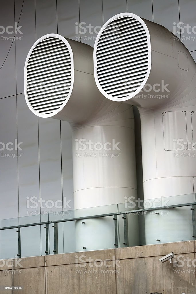 Two large ventilation pipes outside of office building royalty-free stock photo