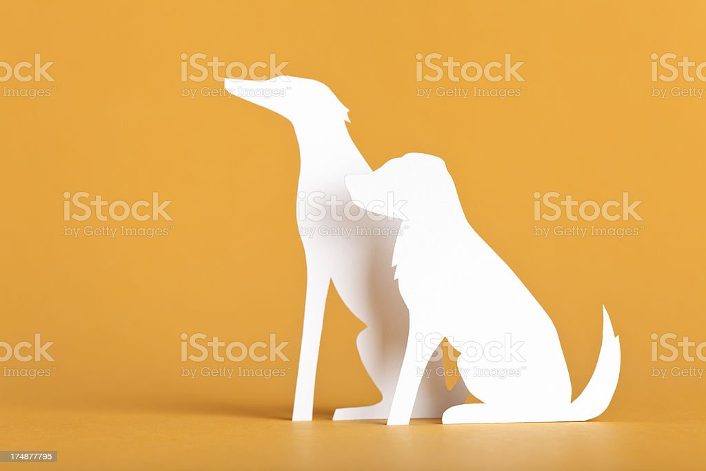 Two large-bred dogs sitting - paper concept stock photo