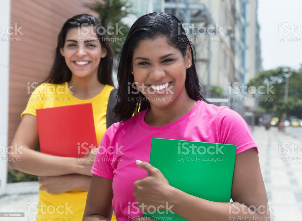 Two latin female students in the city stock photo