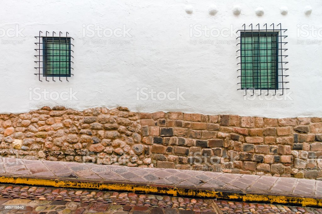 Two latticed windows in a typical house in Cusco (Peru) - Royalty-free Alley Stock Photo