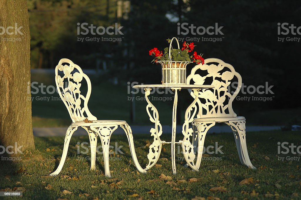 Two Lawn Chairs and a Table Outdoors royalty-free stock photo