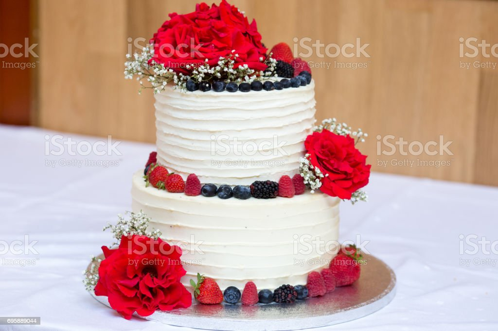 Two Layers Birthday Cream And Berries Cake Decorated With Fresh Red