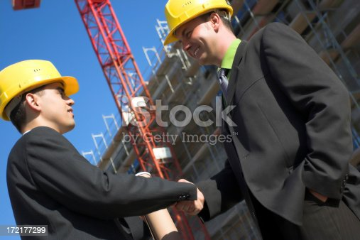 1071990712 istock photo Two leader engineer shaking hands 172177299
