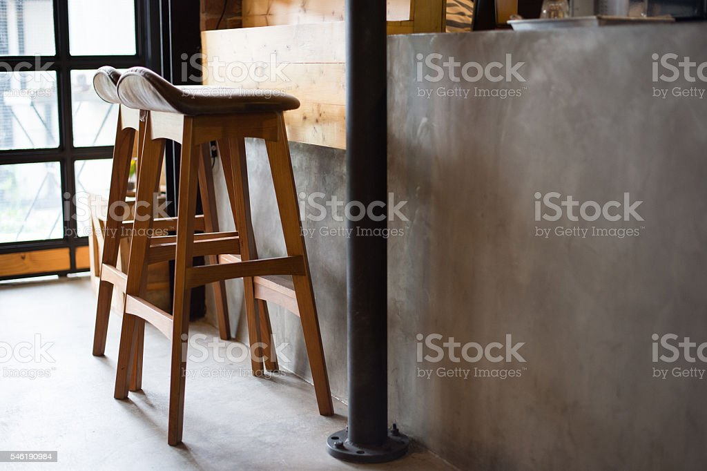 two leather saddles with wooden base stock photo
