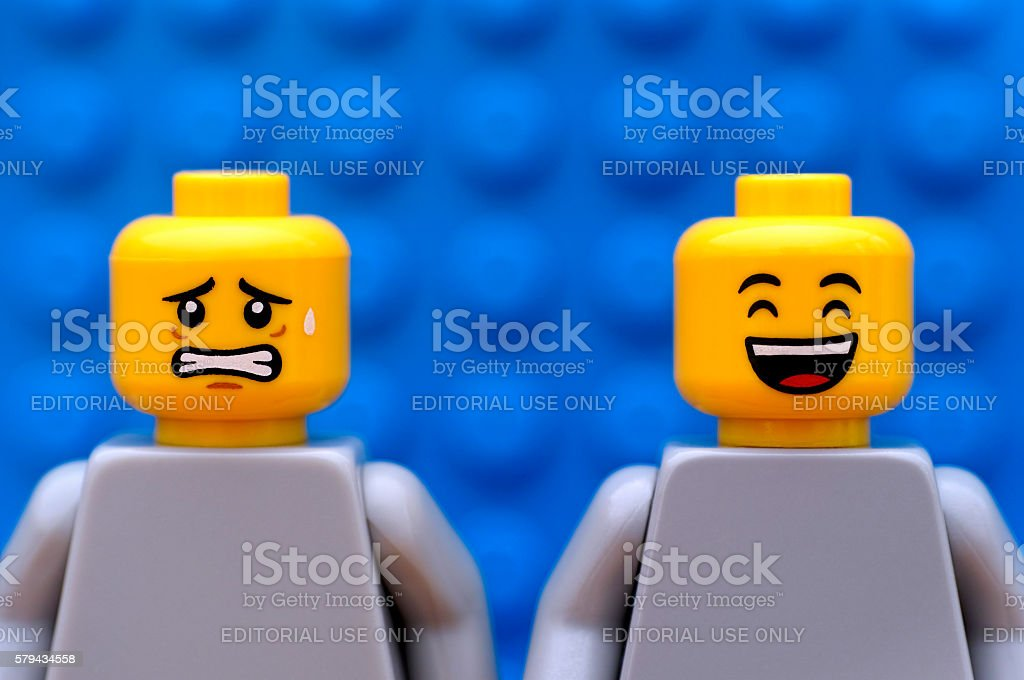 Two Lego minifigures - scared and happy stock photo