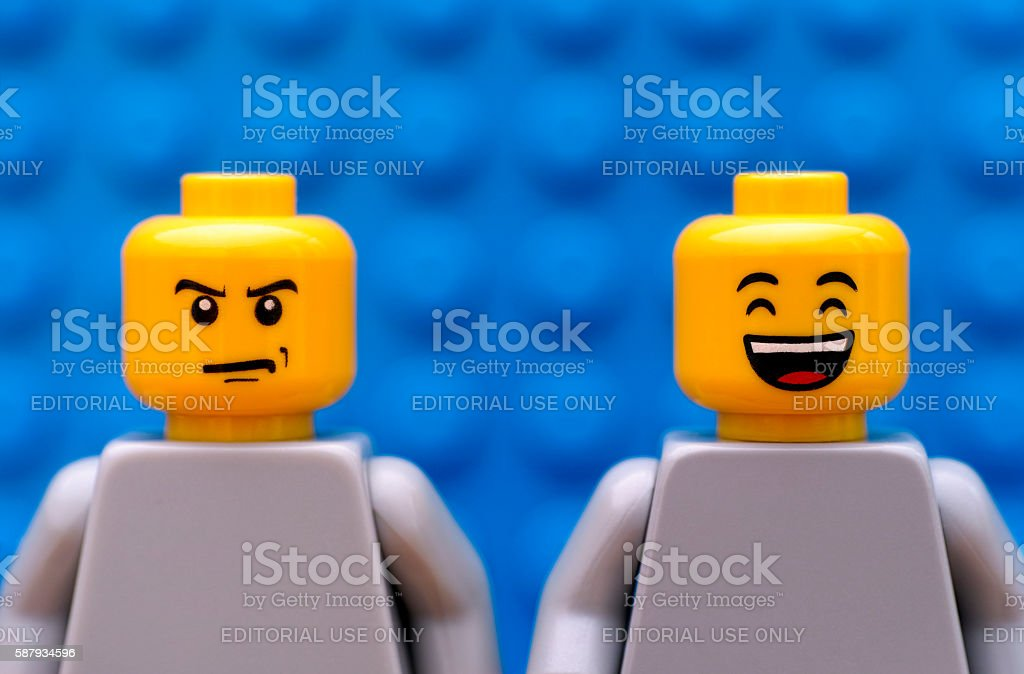 Two Lego minifigures - strict and happy stock photo