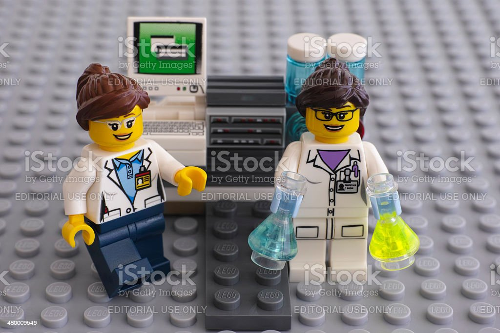 Two LEGO scientists near laboratory computer stock photo