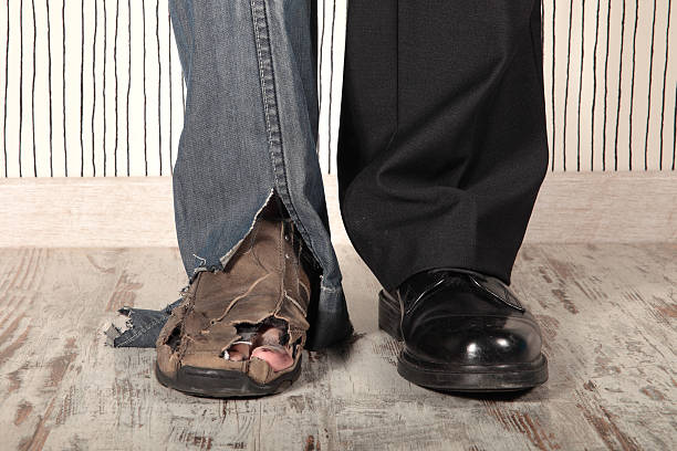 two legs showing the difference between rich and poor - poverty stock pictures, royalty-free photos & images