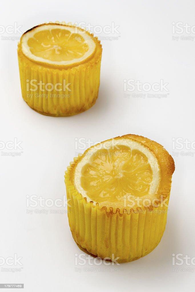 Two lemon muffins on white background stock photo