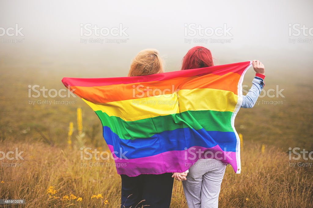 Two lesbian women on the top of the world stock photo