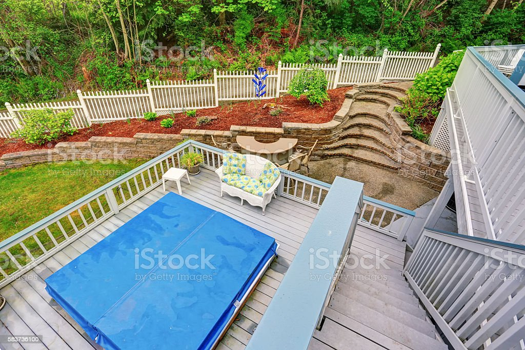 Two level backyard deck with jacuzzi stock photo
