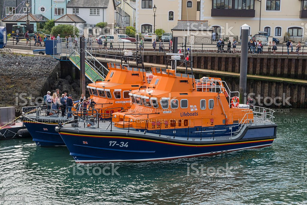 Two lifeboats side by side stock photo