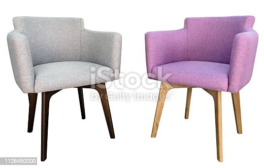 Two lilac and gray modern chairs with wingback side view isolated white background.