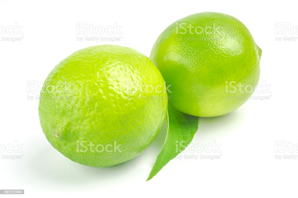 Two lime with leaf isolated on white background photo libre de droits